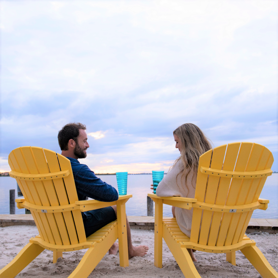 Couple Sitting in Chairs Looking Out at the Sunset