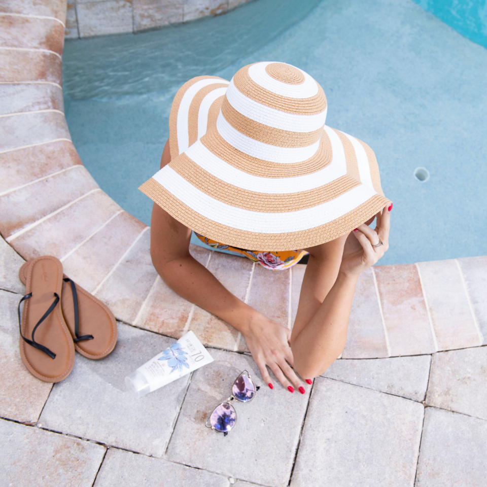 Girl In Pool With Botanical SPF 70 Sunscreen Lotion