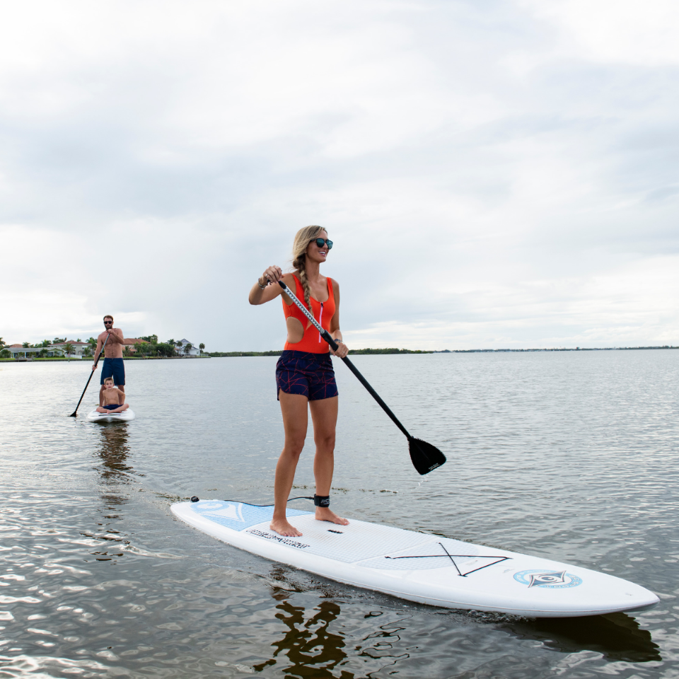 Girl and Family Paddleboarding